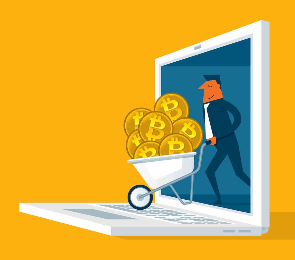 Taxas de bitcoins em carrinho de mão saindo do notebook
