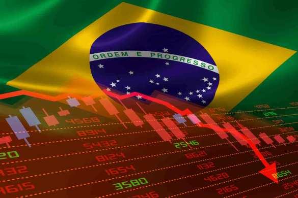 bandeira do Brasil com gráficos da bolsa caindo