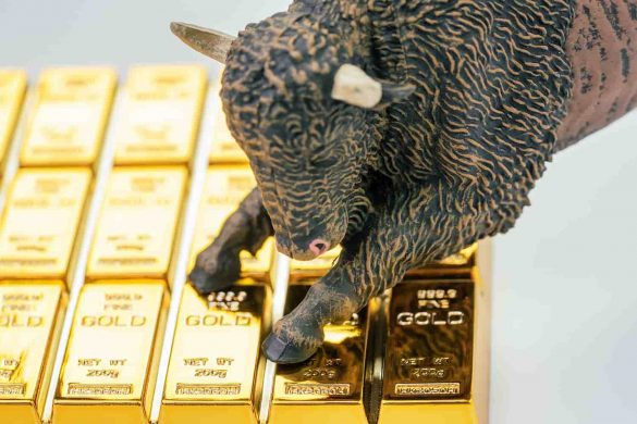 touro em cima de barras de ouro