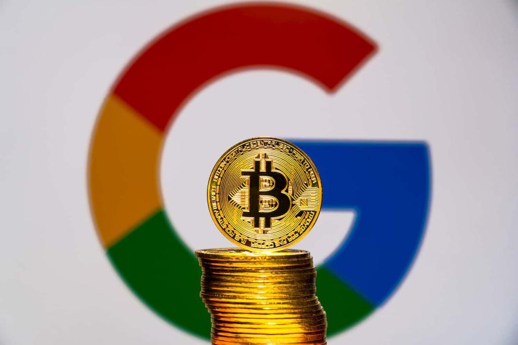 Logo do Google e moeda de bitcoin