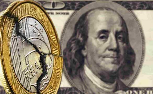 nota de dólar e moeda de real quebrada