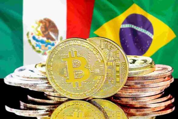 Moedas de bitcoin e bandeiras do Brasil e México ao fundo