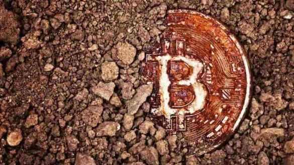 Moeda de Bitcoin enterrada