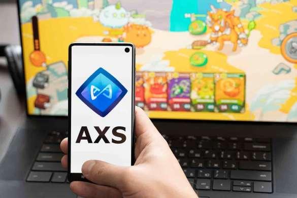 Símbolo do AXS no celular com fundo de jogo